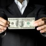 Man holding money large