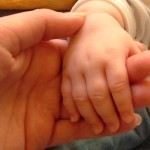 child hand in adult hand