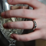 wedding ring on champagne glass