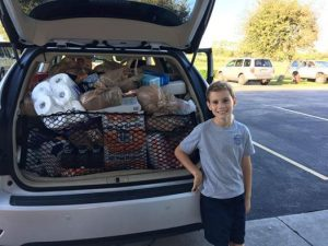Joey Ferraro, 10, with another load headed to Missionary Flights International